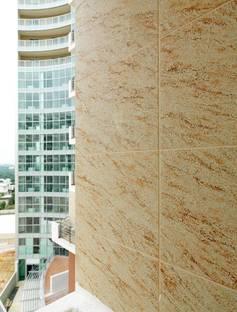 Il rivestimento Pietra Dorata di Granitifiandre e il vetro